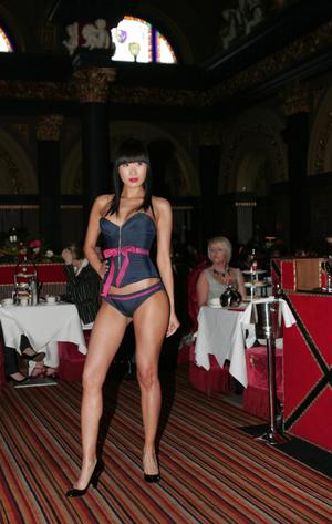 Model Yomiko Chen wearing a stunning denim combo from Agent Provocateur