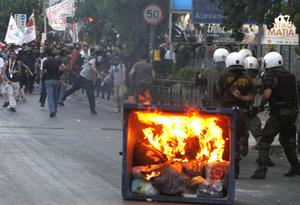 Protesters clash with police officers outside the Israeli embassy in Athens, Monday, May 31, 2010