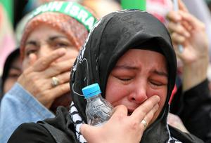 A protester cries during a demonstration at Taksim square in Istanbul, Monday, May 31, 2010