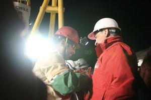 SAN JOSE MINE, CHILE - OCTOBER 12: (NO SALES, NO ARCHIVE) In this handout from the Chilean government, Mario Sepulveda, 39, the second miner to exit the rescue capsule, shakes hands with Chilean President Sebastian Pinera (R) October 12, 2010 at the San Jose mine near Copiapo, Chile. The rescue operation has begun bringing up the 33 miners, 69 days after the August 5th collapse that trapped them half a mile underground. (Photo by Hugo Infante/Chilean Government via Getty Images)