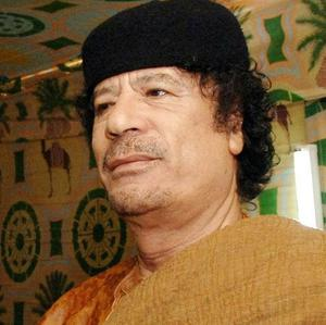 MI5 agents are accused of supplying information about opponents of Colonel Muammar Gaddafi's regime to Libyan intelligence officers