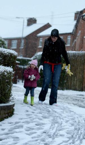 Up to 10 centimetres of snow has fallen in some parts of Northern Ireland causing disruption to flights and forcing the closure of some schools February 2009