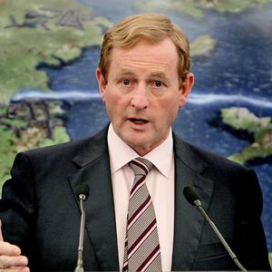 Taoiseach Enda Kenny has come under fire for using his mobile phone during a meeting with the Pope