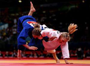 Great Britain's Sarah Clark (left) is thrown by France's Automne Pavia during their WomenÕs 57kg Judo bout at the ExCel North Arena 2, London, on the third day of the London 2012 Olympics.