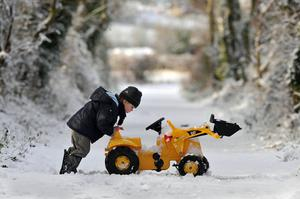 A child attempts to get his plough moving near Aldergrove, County Antrim