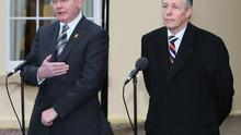 Northern Ireland's First and Deputy First Ministers Peter Robinson (right) and Martin McGuinness (left) disagree in front of the cameras over  policing and justice