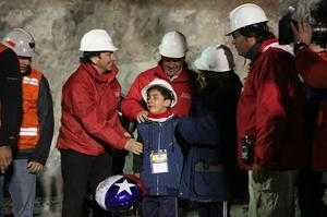 SAN JOSE MINE, CHILE - OCTOBER 12: (NO SALES, NO ARCHIVE) In this handout from the Chilean government, Chilean President Sebastian Pinera and Mining Minister Laurence Golborne stand with the family of Florencio Avalos while waiting for the trapped miner to exit the mine in the rescue capsule October 12, 2010 at the San Jose mine near Copiapo, Chile. The rescue operation has begun bringing up the 33 miners, 69 days after the August 5th collapse that trapped them half a mile underground. (Photo by Hugo Infante/Chilean Government via Getty Images)