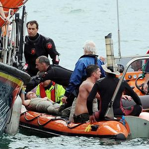 CBBC presenter Holly Walsh is hauled from the water after injuring herself during the Worthing International Birdman competition