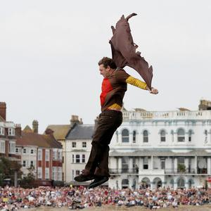 A competitor leaps off the pier at the Worthing International Birdman competition