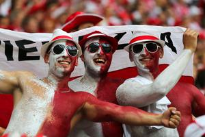 WARSAW, POLAND - JUNE 12: Polish fans soak up the atmopshere during the UEFA EURO 2012 group A match between Poland and Russia at The National Stadium on June 12, 2012 in Warsaw, Poland.  (Photo by Alex Grimm/Getty Images)