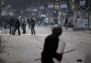 Egyptian anti-government activists throw stones on riot police during clashes in Cairo, Egypt, Wednesday, Jan. 26, 2011. Egyptian anti-government activists clashed with police for a second day Wednesday in defiance of an official ban on any protests but beefed up police forces on the streets quickly moved in and used tear gas and beatings to disperse demonstrations. (AP Photo/Ben Curtis)