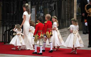Pippa Middleton arrives at Westminster Abbey with the bridesmaids and page boys ahead of the wedding between Prince William and Kate Middleton