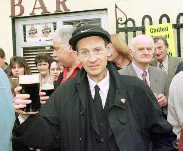 Alex Higgins   in 1999 at his friend Ollie Reed's funeral in County Cork