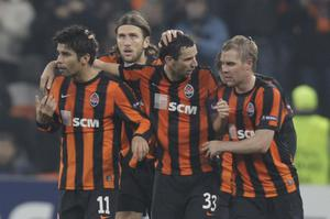 Shakhtar Donetsk's players reacts after scoring against Arsenal during their Champions League group H soccer match  in Donetsk, Ukraine, Wednesday, Nov. 3, 2010. (AP Photo / Efrem Lukatsky)