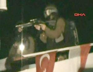 This video image released by the Turkish Aid group IHH Monday May 31, 2010 purports to show Israeli soldiers aiming a gun on the deck of a Turkish ship, part of an aid convoy heading to the Gaza Strip