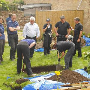 Specialist officers from Sussex Police search the garden of a house in Station Road, Portslade