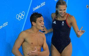 Great Britain's Tom Daley takes a shower after practice next to Tonia Couch at the Aquatics Centre at Olympic Park, London. PRESS ASSOCIATION Photo. Picture date: Thursday July 26, 2012. Photo credit should read: Mike Egerton/PA Wire. EDITORIAL USE ONLY