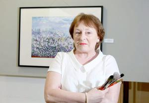 Art therapy — Bridget Weir with some of her work at the Ulster Cancer Foundation's Emotions exhibition in Belfast