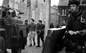 A man is taken away by troops in the Markets area, Belfast as searches followed vicious shooting battles between gunmen and army. 11/8/1971.