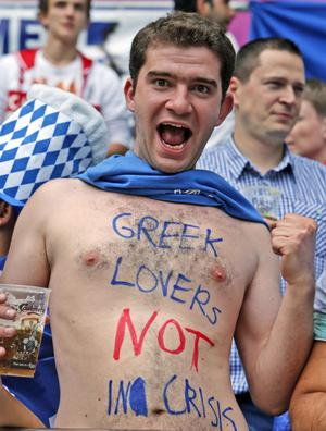 A Greek fan cheers before the Euro 2012 soccer championship Group A match between Greece and Czech Republic in Wroclaw, Poland, Tuesday, June 12, 2012. (AP Photo/Thanassis Stavrakis)