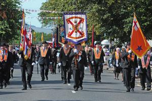 The Grand Lodge of Ireland banner leads the way during the County Londonderry Twelfth of July celebration in Limavady on tuesday. PIcture Martin McKeown. Inpresspics.com. 12.7.11