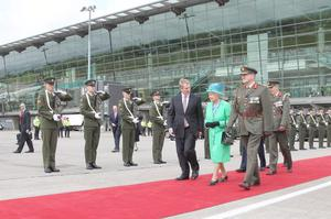 Taoiseach Enda Kenny TD,  Queen Elizabeth II  and Lt Gen SÈan McCann, Chief of Staff of the Defence Forces  inspecting a guard of honour before departing from Cork Airport after the four day  State Visit to Ireland.  PRESS ASSOCIATION Photo.