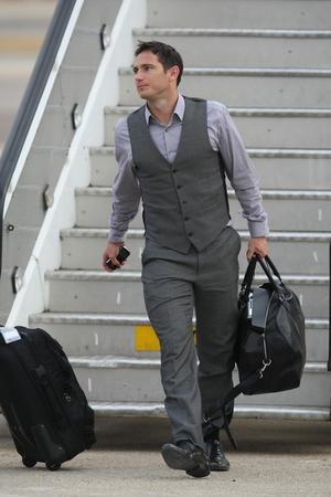 England's Frank Lampard arrives at Heathrow Airport, London. The England team returned to the UK after a 4-1 defeat to Germany in the Round of 16 match in Bloemfontein, South Africa on Sunday
