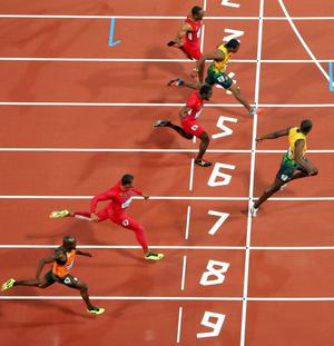 LONDON, ENGLAND - AUGUST 05:  Usain Bolt of Jamaica crosses the line to win gold in the MenÂs 100m Final on Day 9 of the London 2012 Olympic Games at the Olympic Stadium on August 5, 2012 in London, England.  (Photo by Ian Walton/Getty Images)