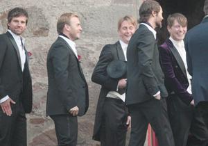 Mark Owen (right) with fellow Take That members Howard Donald (left), Jason Orange (second right) and Gary Barlow (second left) arrive at Cawdor parish Church in Cawdor, Nairn where Owen married Emma Ferguson at a service. PRESS ASSOCIATION Photo. Picture date: Sunday November 9, 2009. Photo credit should read: David Cheskin/PA Wire