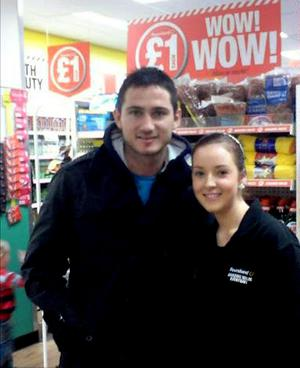Above: Chelsea footballer Frank Lampard poses for a photograph with a young fan in Poundland in Newtownards