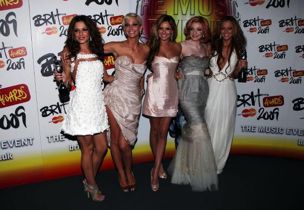 LONDON - FEBRUARY 18:  Girls Aloud Cheryl Cole, Sarah Harding, Nadine Coyle,  Nicola Roberts and Kimberley Walsh pose after winning the Best British Single backstage at the Brit Awards 2009 at Earls Court on February 18, 2009 in London, England.  (Photo by Tim Whitby/Getty Images)