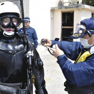 A frogman is screened for leaked radiation in north-eastern Japan (AP)