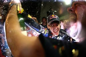 ABU DHABI, UNITED ARAB EMIRATES - NOVEMBER 14:  Sebastian Vettel of Germany and Red Bull Racing celebrates with his team after winning the driver's championship during the Abu Dhabi Formula One Grand Prix at the Yas Marina Circuit on November 14, 2010 in Abu Dhabi, United Arab Emirates.  (Photo by Vladimir Rys/Getty Images) *** BESTPIX ***