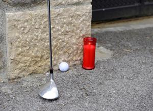 PEDRENA, SPAIN - MAY 07:  A golf club, golf ball and a candle stand in tribute for late Spanish golf legend Seve Ballesteros at the entrance gate of his home on May 7, 2011 in Pedrena near Santander, Spain. Ballesteros, who won 87 titles overall including five majors, passed away in the early hours of Saturday after a battle with cancer.  (Photo by Ander Gillenea/Getty Images)