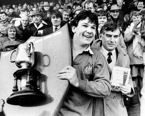 Bangor captain, Michael Webb, collects the Schools' Cup.  17/3/1985