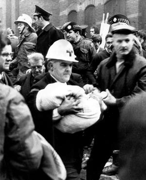 December 1971 An ambulance man carries the body of baby Colin Nicholl from the wreckage of the Balmoral Furnishing Company on the Shankill Road in Belfast following a 'no warning' Provisional IRA bomb which killed 2 babies and 2 adults as well as injuring scores of other people on a Saturday afternoon - just before Christmas. Picture by Alan Lewis