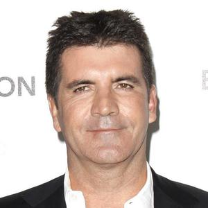 Simon Cowell sparked speculation when he was snapped driving his car