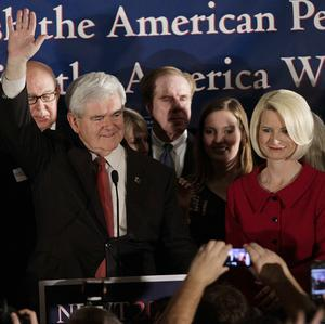 Newt Gingrich arrives with his wife Callista during a Republican primary night rally in Columbia, South Carolina (AP)