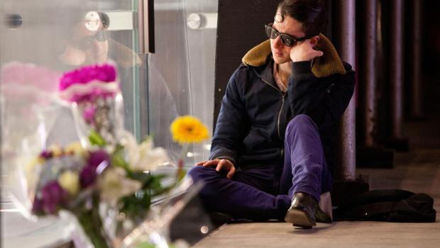 Mario Spinetti sits outside the Apple Store on West 66th Street after hearing of the deat of Steve Jobs, founder and former CEO of Apple Inc., in the early hours of October 6, 2011 in New York City.