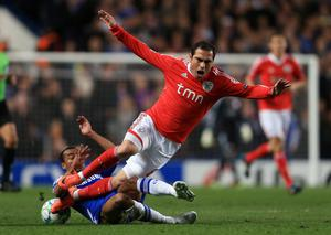 LONDON, ENGLAND - APRIL 04:  Ashley Cole of Chelsea challenges Bruno Cesar of Benfica during the UEFA Champions League Quarter Final second leg match between Chelsea and Benfica at Stamford Bridge on April 4, 2012 in London, England.  (Photo by Clive Rose/Getty Images)