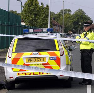 Police at the scene in the Norris Green area of Liverpool after a man was shot dead
