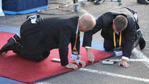 Staff at Edinburgh Airport prepare the red carpet for Pope Benedict XVI ahead of his arrival there at the start of his four day visit to the United Kingdom