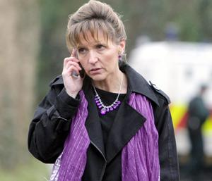 Foyle Assembly Member, Martina Anderson, at the cordoned off scene on the Braehead road in Londonderry near the Irish border, after the body of a man was found shot dead, stripped and with his hands tied.
