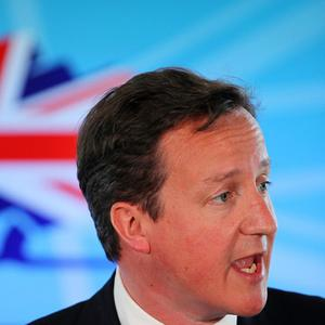 Changing the electoral system could pave the way for keeping 'dead governments on life support', David Cameron said