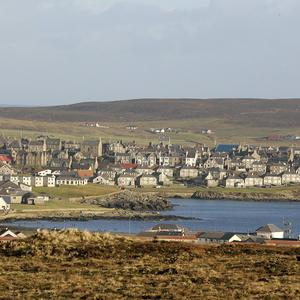 A ship with 100 people on board has run aground in Lerwick harbour