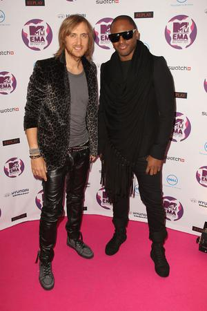 BELFAST, NORTHERN IRELAND - NOVEMBER 06:  DJ and music producer David Guetta and singer Taio Cruz attends the MTV Europe Music Awards 2011 at the Odyssey Arena on November 6, 2011 in Belfast, Northern Ireland.  (Photo by Dave J Hogan/Getty Images)