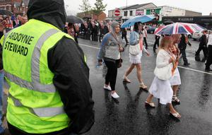 Press Eye - Belfast - Northern Ireland - 12th July 2011 - Picture by Jonathan Porter/ PressEye.com -  Orange Order feeder parade past the Ardoyne shops in north Belfast.  Nationalist residents staged a protest in response to the parade which was heading to join the main Belfast 12th July Orange Order demonstration.