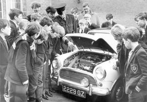 """""""Z-car drivers were bombarded with questions when they arrived at Dunlambert Secondary School, Belfast, with their cars. They were giving a road safety demonstration along with the R.U.C accident prevention unit, 1966."""