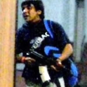A still taken from Indian TV of an armed man at the Chhatrapati Sivaji railway station in Mumbai