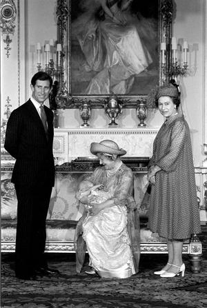 1982: Four generations of the Royal Family. Britain's Queen Elizabeth II and Prince Charles watch as the Queen Mother holds Prince William at his christening at Buckingham Palace.  PA Photo